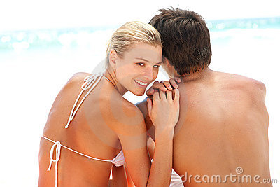 Couple sitting together at the beach