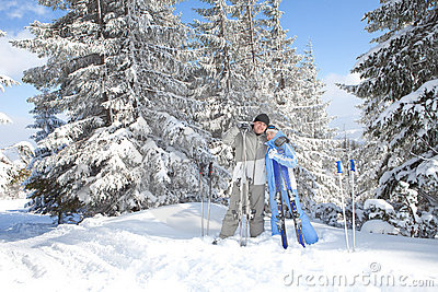 Couple with ski in the winter landscape