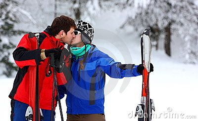 Couple on a skiing holiday kissing