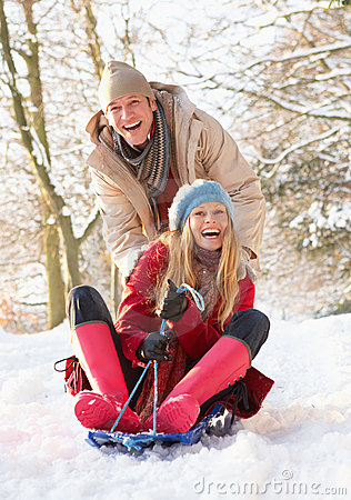 Free Couple Sledging Through Snowy Woodland Royalty Free Stock Photo - 12989015