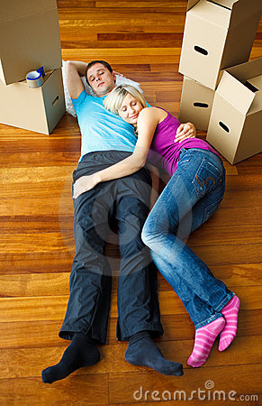Couple sleeping on the floor. Moving house