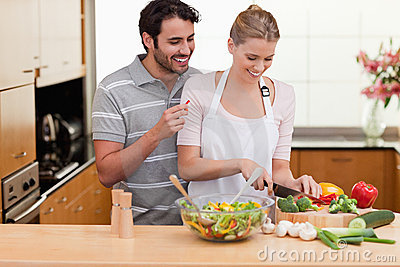 Couple slicing vegetables