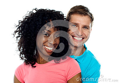 Couple smiling with joy. Hugging in love