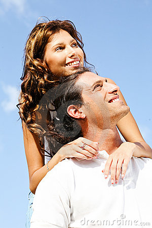 Couple smiling and looking away