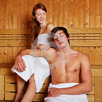 Couple smiling in sauna