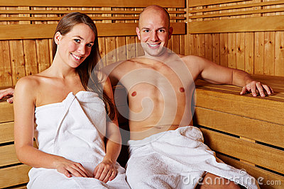 Couple smiling in the sauna