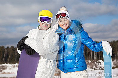 Couple with snowboards in their hands