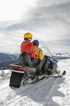 Couple on snowmobile.