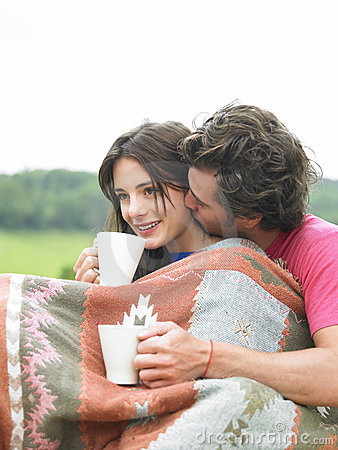 Couple Snuggling And Drinking Tea Stock Image Image
