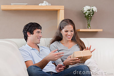 Couple on the sofa with parcel
