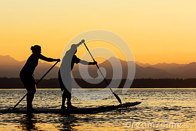 Couple on Stand Up Paddle Boards