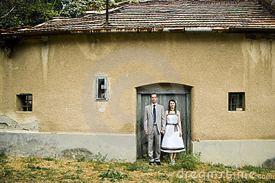 Couple standing on the door of a house.