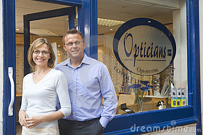 Couple standing at entrance of optometrists