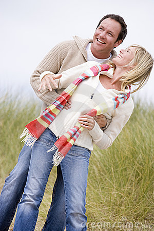Free Couple Standing On Beach Smiling Stock Images - 5937584