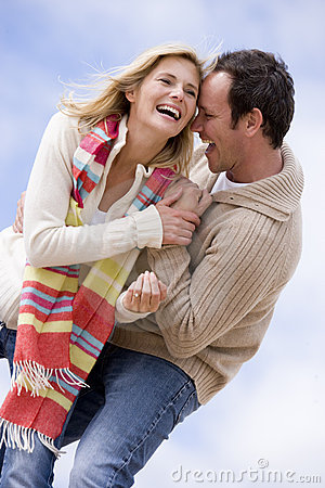 Free Couple Standing Outdoors Smiling Stock Photo - 5937590
