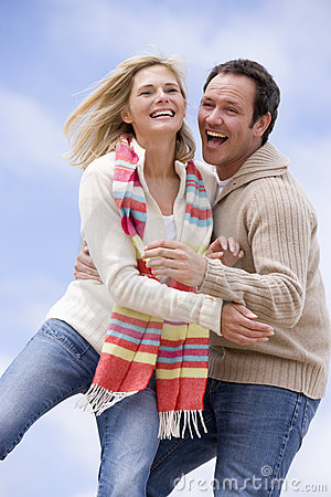 Free Couple Standing Outdoors Smiling Stock Photo - 5937600