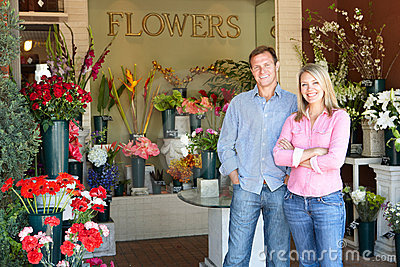 Couple standing outside florist