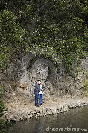 Couple Standing on Side of Lake