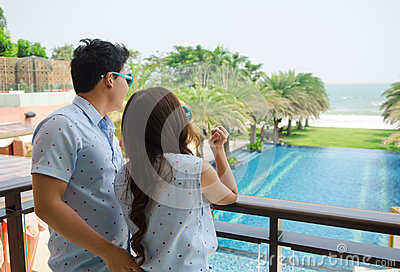 Couple standing at the terrace and looking to sea Stock Photo