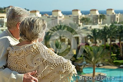 Couple standing on terrace Stock Photo