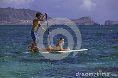 Couple on standup paddle board
