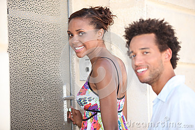 Couple stood by a door