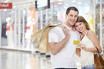 Couple in store with a credit card