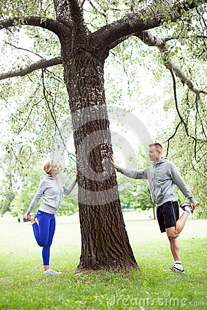 Couple stretching outdoors