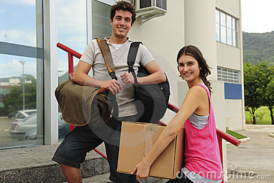 Couple of students moving in to the campus