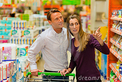 Couple in supermarket with shopping cart