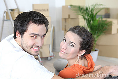 Couple surrounded by packing boxes