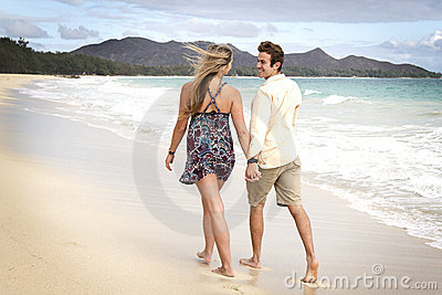 Couple take a walk on the beach