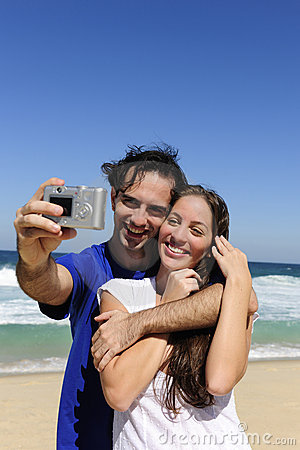 Couple taking a photo with digital camera