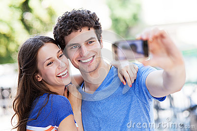 Couple taking photo of themselves