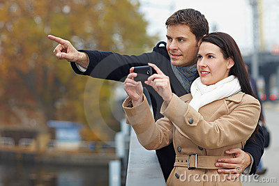 Couple taking pictures with mobile