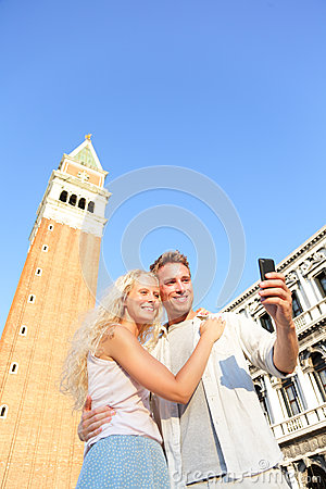 Couple taking selfie picture on travel in Venice