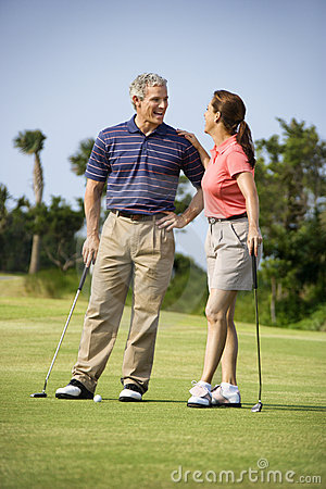 Couple talking on golf course