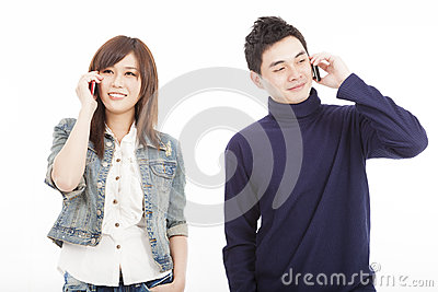 Couple talking on mobile phone