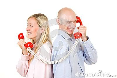Couple talking on telephone