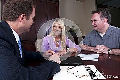 Couple talking to advisor
