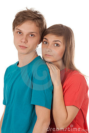Couple of teenagers in color clothes