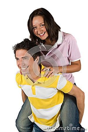 Couple of teenagers in piggyback