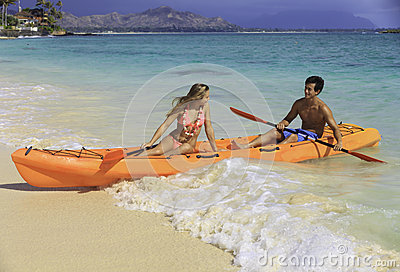 Couple in their kayak at the beach