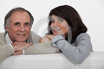 Couple on their sofa.