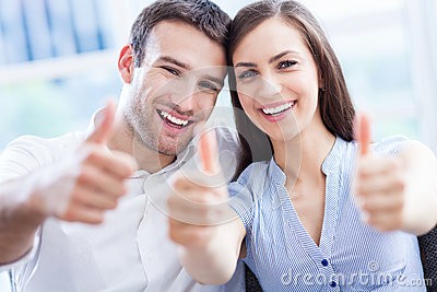 Couple with thumbs up