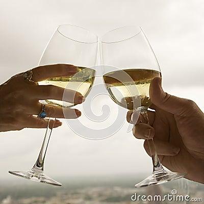 Couple toasting.