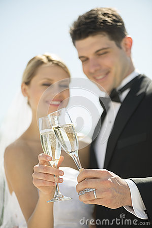 Couple Toasting Champagne Flutes Outdoors