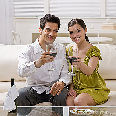Couple toasting red wine celebrating anniversary