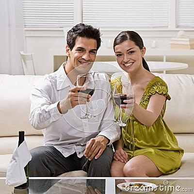 Couple toasting red wine celebrating anniversary