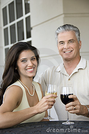Couple toasting wine.